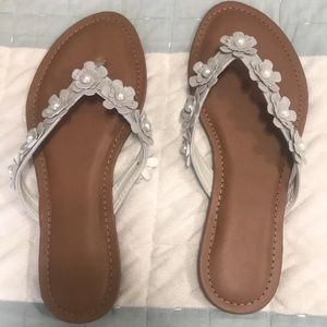 Shoes - NWT flip flops  grey with flower details. $10